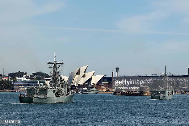 A flotilla of Royal Australian Navy warships enter Sydney Harbour on October 5 2013 in Sydney Australia Over 50 ships participate in the...