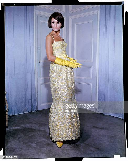 A flounce of eleganceJacques Heim of Paris creates youthful elegance in his new Fall 1963 collection with this toelength gown done in a lustrous...