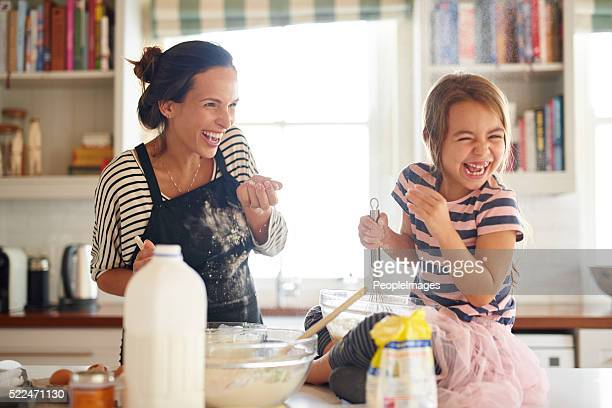 flour and fun make for some delicious food! - mother daughter stock photos and pictures