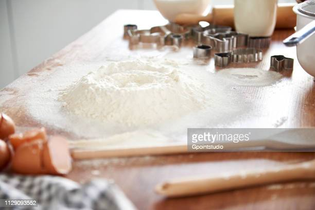 Flour, baking utensils on kitchen top