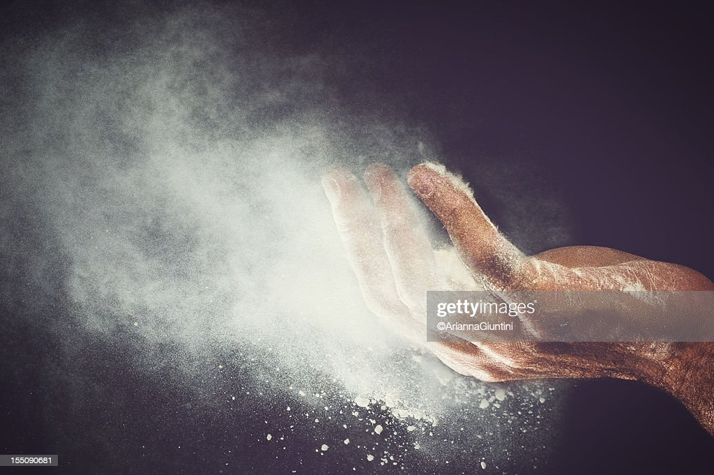 flour blew from the hand : Stock Photo