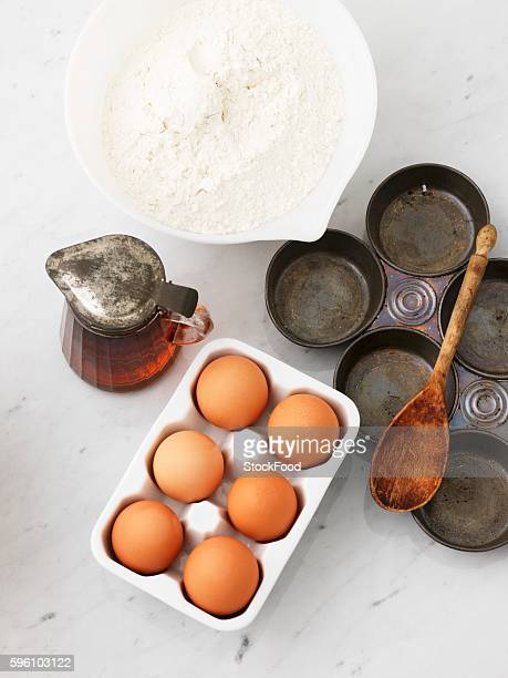 Flour, eggs, maple syrup and a baking tin