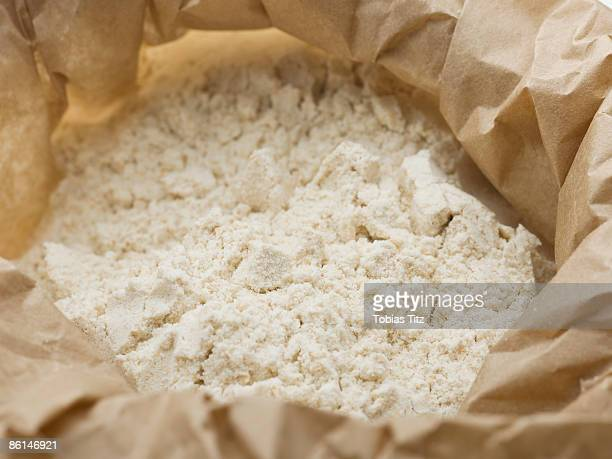 flour in a paper bag - flour stock pictures, royalty-free photos & images