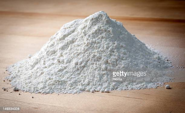 flour on the wooden table - flour stock pictures, royalty-free photos & images