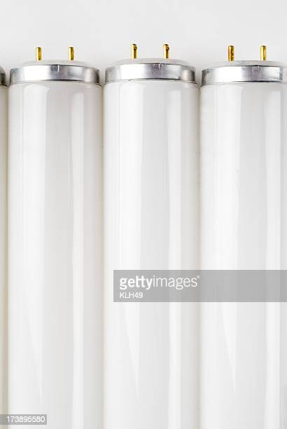 flourescent light bulbs - fluorescent stock photos and pictures