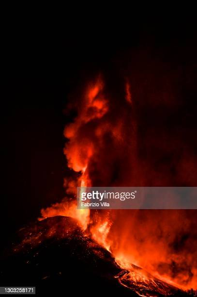 Flow generated by an overflow on the eastern flank of the cone is heading into the Bove valley on February 21, 2021 in Catania, Italy. Since the...