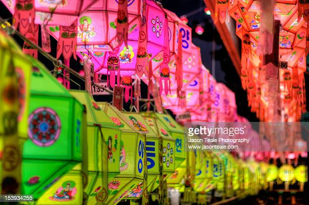 a flow of colourful asian buddhist lanterns - buddha's birthday stock pictures, royalty-free photos & images