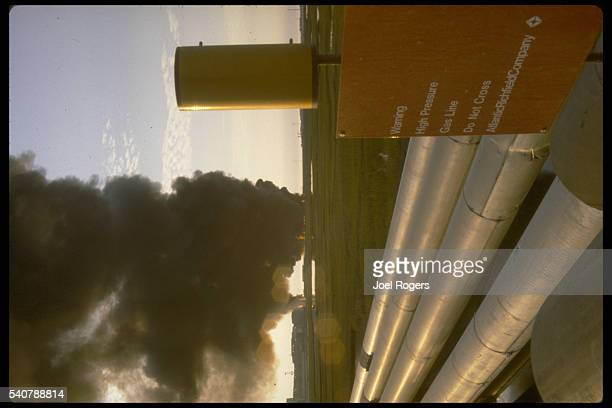 Flow Station 2 of the TransAlaska Pipeline burns off crude and gas producing thick black smoke North Slope Prudhoe Bay Alaska USA