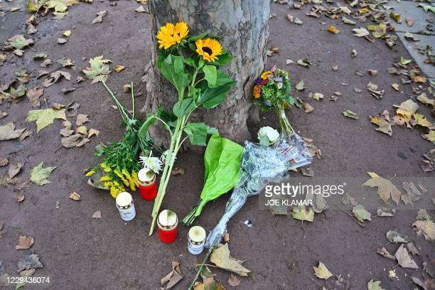 Flower and candles for the victims of the shooting lay at Schweden square in Vienna on November 03 after the multiple shootings leaving four people...