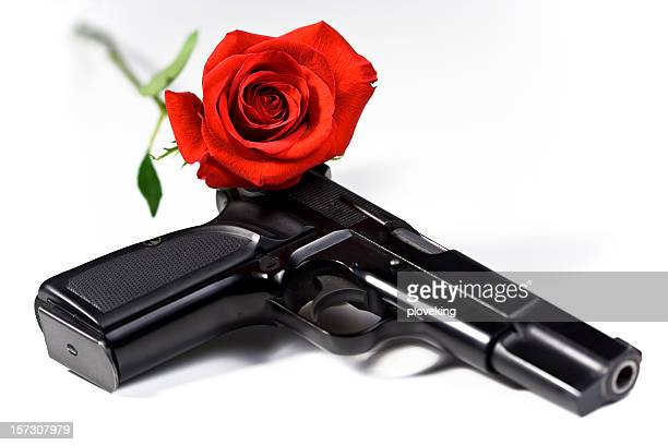 flower and gun - black rose stock pictures, royalty-free photos & images