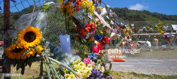 Flower are seen on the fence near the Whakatane Wharf on December 13 2019 in Whakatane New Zealand Six bodies have been successfully recovered from...