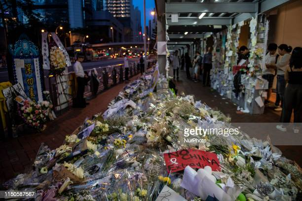 Flower are seen on the ground in Honor of a man who died after falling from a scaffolding in Pacific Place while protesting demanding the complete...