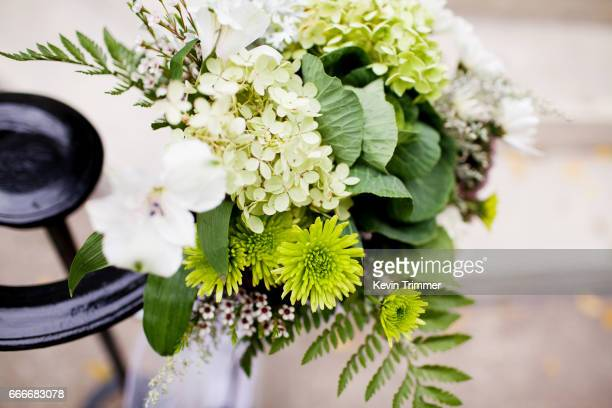 flower arrangement on railing - church wedding decorations stock pictures, royalty-free photos & images
