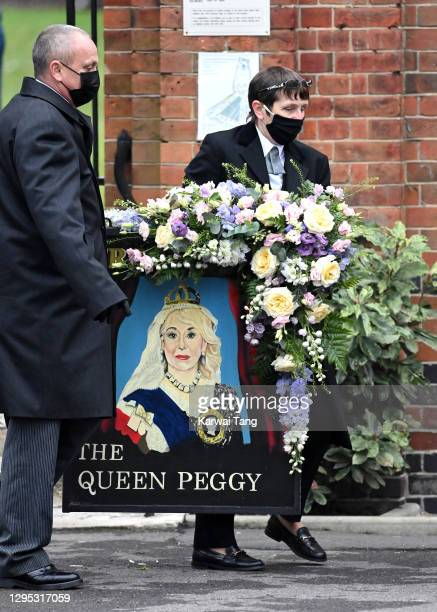 Flower arrangements at the funeral of Dame Barbara Windsor at Golders Green Crematorium on January 08, 2021 in London, England. Actress Dame Barbara...