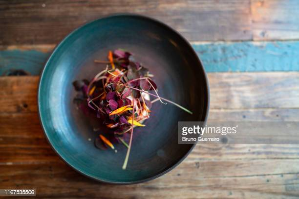 flower based vegetarian plate on rustic wooden table - danish food stock pictures, royalty-free photos & images