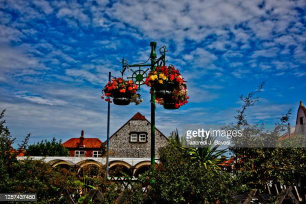 flower baskets in sheringham norfolk - bavosi stock pictures, royalty-free photos & images