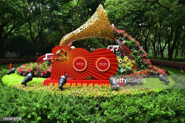 Flower beds are seen set up at Xujiahui to celebrate the centenary of the Communist Party of China on June 18, 2021 in Shanghai, China.