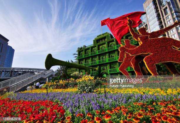 Flower beds are set up on the streets of Beijing to celebrate the centenary of the founding of the Communist Party of China, June 15 in Beijing,...