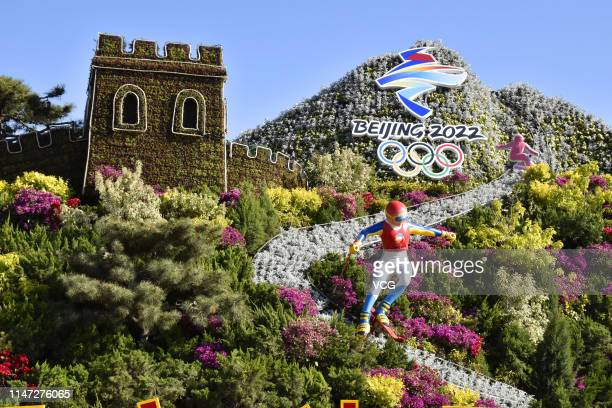 Flower beds with a decoration reading 'Beijing 2022' are seen during the 2019 Beijing International Horticultural Exhibition at Yanqing District on...
