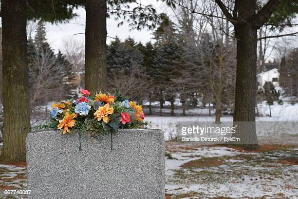 Flower Bouquet On Tombstone