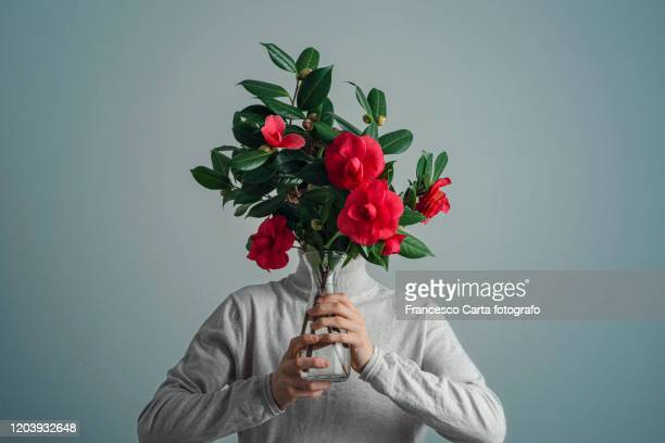 flower bouquet - obscured face stock pictures, royalty-free photos & images