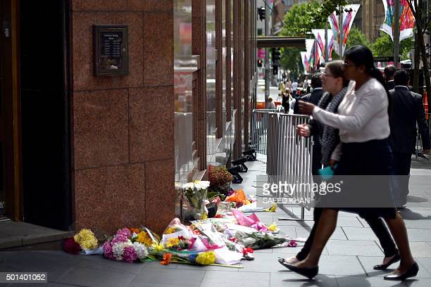 Flower bouquets with messages are seen at the entrance to the Lindt Café on the first anniversary of the siege by a selfstyled Islamic cleric at...