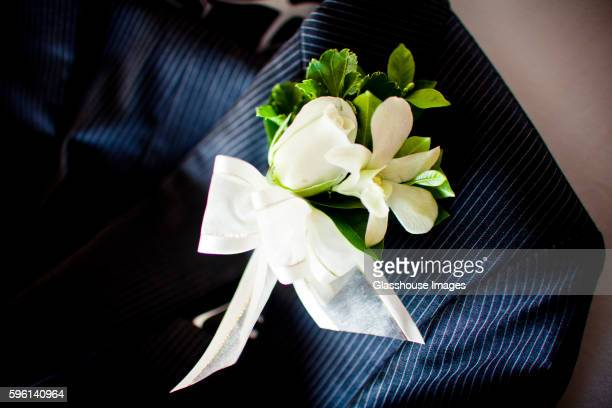 Flower Boutineer Pinned To Tuxedo Lapel