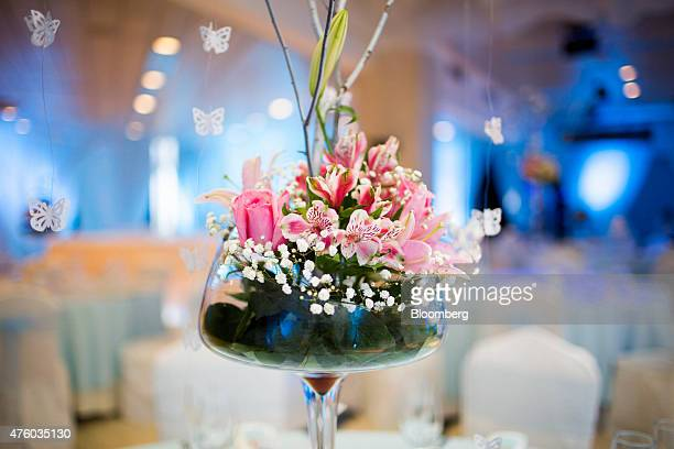A flower centerpiece sits on a table during a quinceanera celebration at the Melia Cohiba hotel in Havana Cuba on Saturday March 28 2015 The...