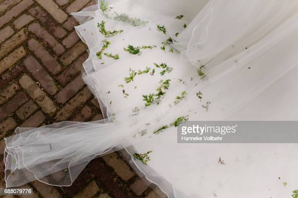 Flower confetti on bride's wedding dress