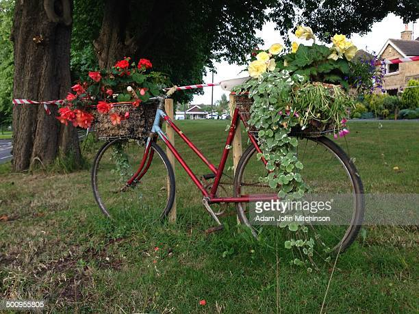 Flower decorated bike along Tour de France route through Pool in Wharfedale West Yorkshire UK