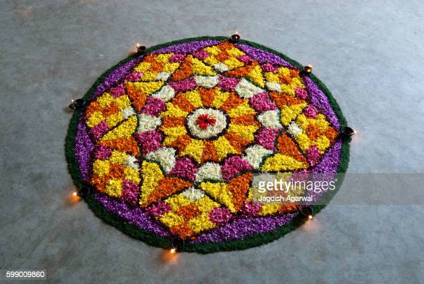flower decoration for onam festival, kerala, india - rangoli stock pictures, royalty-free photos & images