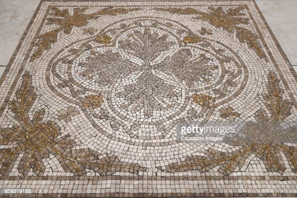 Flower design Cross of Saint Florian mosaic tiles on the floor of a Toronto Roman Catholic church