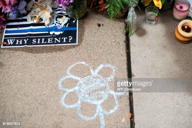 A flower drawn on the ground is seen on July 18 2017 in Minneapolis Minnesota near a memorial for Justine Damond Scrutiny intensified into the death...