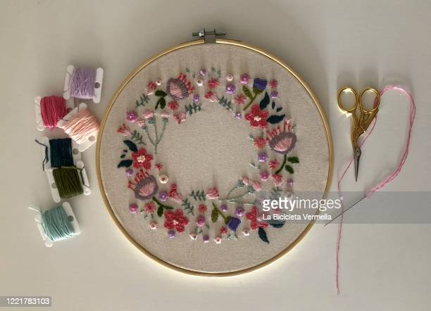 flower embroidery on frame - embroidery stock pictures, royalty-free photos & images