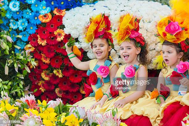 flower festival in madeira portugal kids at parade - madeira island stock photos and pictures