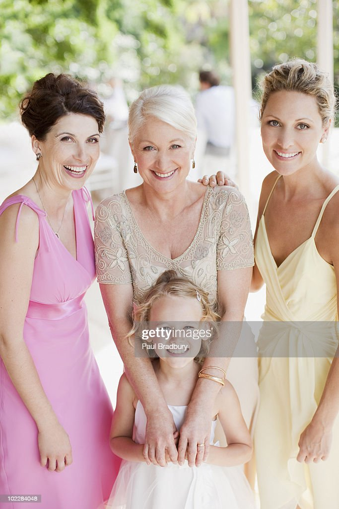Flower girl and bridal party smiling : Stock Photo