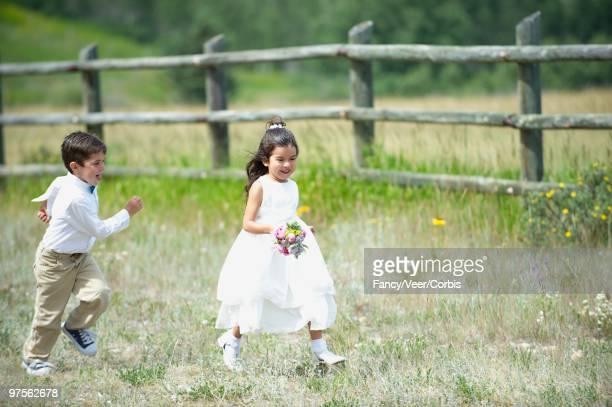 Flower Girl and Ring Bearer Running
