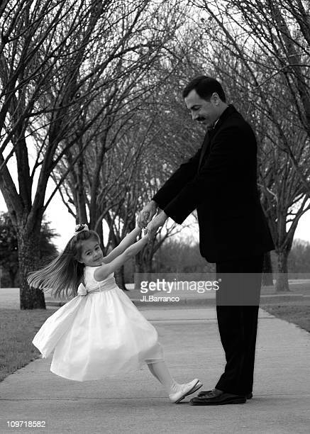 Flower Girl Dancing with Father, Black and White