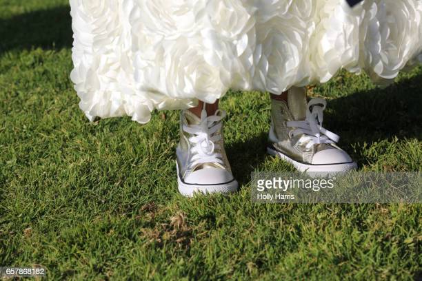 flower girl in a puffy dress with sneakers - mismatched clothes stock pictures, royalty-free photos & images
