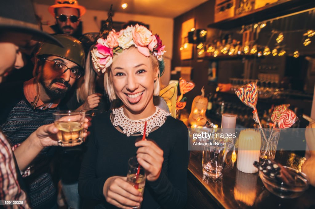 Flower girl on Halloween party : Stock Photo