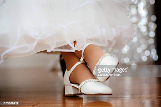 flower girl waiting to dance - silver shoe stock pictures, royalty-free photos & images