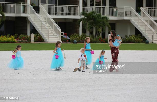 Flower girls during a beach wedding on the beautiful San Marco Beach on Marco Island Florida USA on August 30 2018