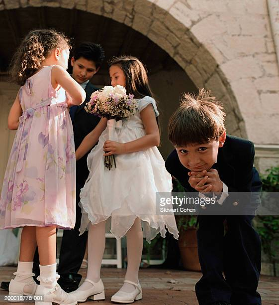 Flower girls with ring bearer, boy (4-6) in foreground
