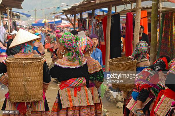 flower hmong woman in traditional dress at the market, vietnam - sapa stock pictures, royalty-free photos & images