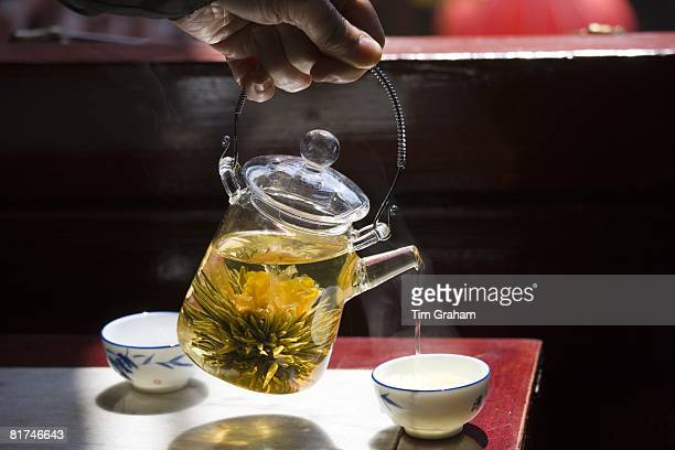 Flower infused tea being poured in the Huxinting Teahouse Yu Garden Bazaar Market Shanghai China