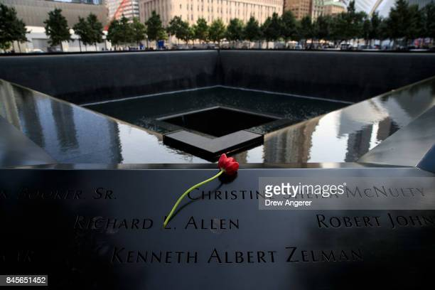 A flower is left at the North pool during a commemoration ceremony for the victims of the September 11 terrorist attacks at the National September 11...
