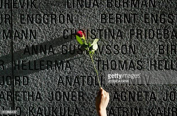 A flower is pictured on a granite wall bearing the names of the victims of the 1994 sinking of the Estonia car ferry in the Baltic Sea during the...