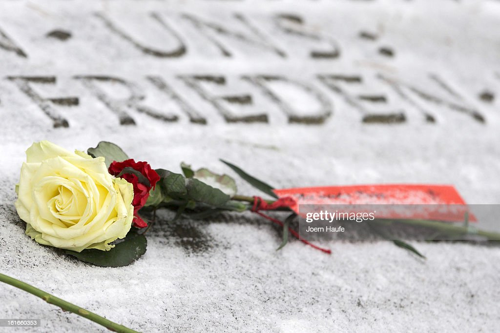A flower lies on a grave at the Heidefriedhof cemetery during a memorial to commemorate the 68th anniversary of the Allied firebombing of Dresden during World War II on February 13, 2013 in Dresden, Germany. Critics charge the bombing targeted the cultural center and civilian population of the city, of whom approximately 22,000 were killed. British and American bombers took part in the raid that took place in the final months of the war.