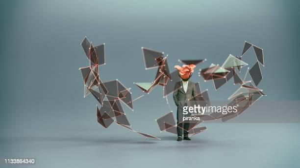 flower man omgeven door deeltjes - omgeven stockfoto's en -beelden