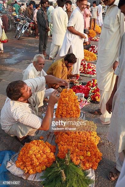 CONTENT] Flower Mandi at Sagiyan Pul Lahore every day the market is establish on the road side from many decades and formers brings their flowers to...
